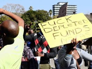 Angry UNISA students striking about depleted funds.